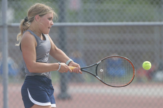 Central Catholic's Annabelle Brouillette hits the ball during an IHSAA sectional tennis doubles match, Thursday, May 20, 2021 in West Lafayette.