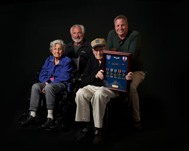 The Diehl family: Annie, in blue, and Harry are seated up front, with their sons Russ, left, and Kevin. Annie and Harry served the country during World War II and recently shared their stories with the Guardians Never Forget project.