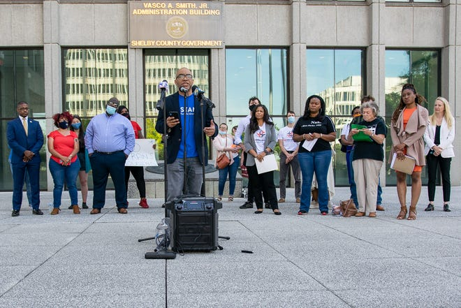 Cardell Orrin, director of Stand for Children, speaks Friday in front of the Vasco A. Smith Jr. Administration Building.
