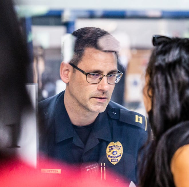Police Capt. Luke Vetter speaks with attorney Kimberley Motley at the Wauwatosa Police Department in June 2020. Vetter will take over as interim police chief when Chief Barry Weber retires June 1.