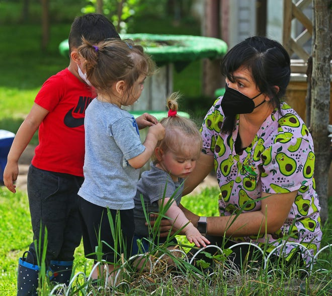 Yimma Davila-Castro, right, conducts a nature exercise with children from Yimma's Bright Beginnings Daycare on May 21.