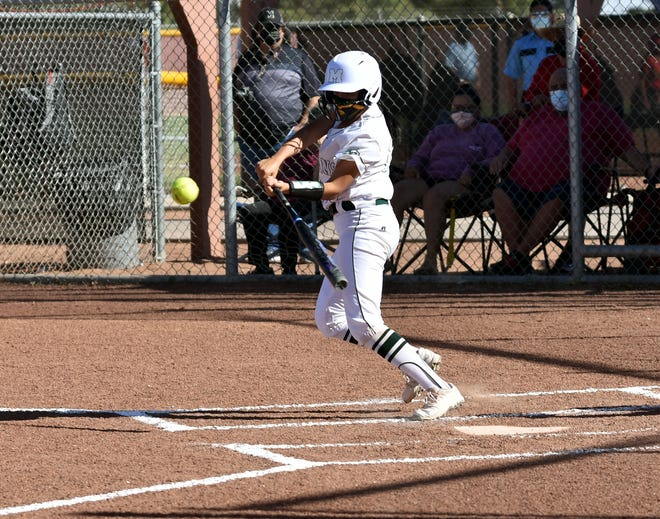 Brianna Maldonado puts the ball in play as the Mayfield Trojans took on the Centennial Hawks in a double header on Thursday night.  Photo taken 5/20/21.