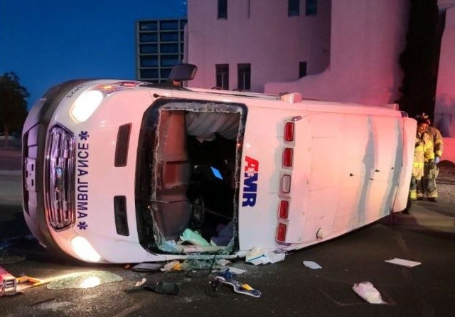 An ambulance lies on its side at the intersection of Amador Avenue and Water Street on Thursday, May 20, 2021, after it was rammed by a Dodge Challenger. The driver of the Dodge has been charged with DWI and running a stop sign.