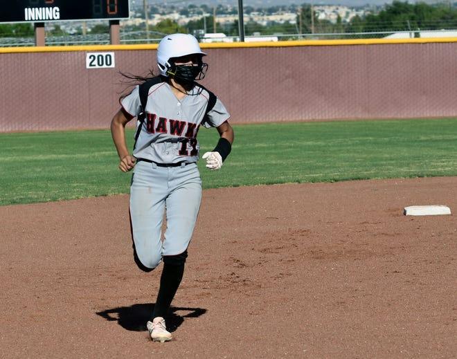 Centennial's Gianna Villegas circles the bases after hitting a two run home run on Thursday night against Mayfield High School.  Photo taken 5/20/21.