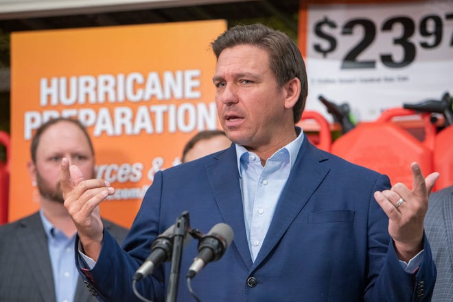 Gov. Ron DeSantis speaks during a press conference at the Home Depot on North Davis Highway in Pensacola, Florida, on Friday, May 21, 2021.  DeSantis signed a nearly $200 million tax holiday package into law at the event.