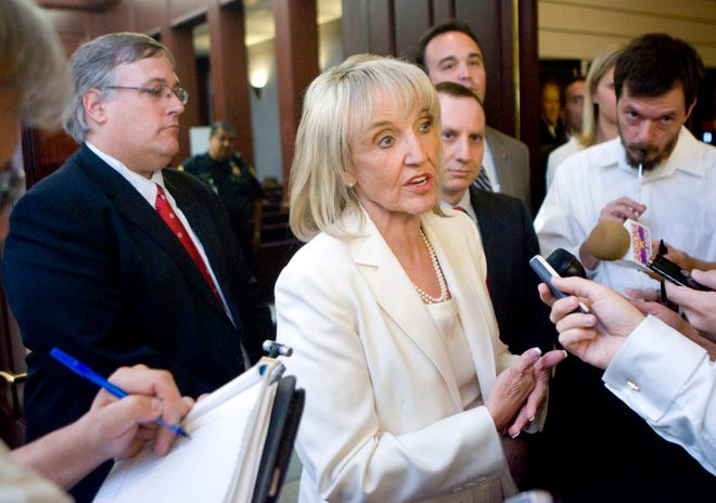 Arizona Gov. Jan Brewer answers questions following a hearing at the Arizona State Supreme Court on June 23, 2009. Brewer sued legislators after they refused to send her a budget plan that they passed earlier this month.