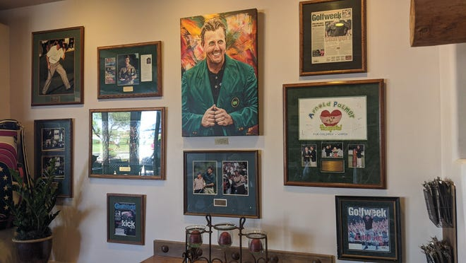 Framed art of Phil Mickelson winning the Masters at Phil's Grill at Grayhawk Golf Club.