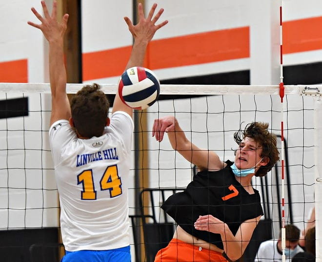 York Suburban's Ben Klimes, right, hits the ball past Linville Hill Christian's Tyler Zook during PIAA District 3, Class 2-A boys' volleyball quarterfinal action at York Suburban, Thursday, May 20, 2021. York Suburban would win the game 3-0. Dawn J. Sagert photo