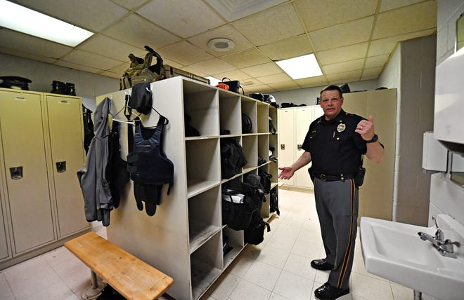 Police Chief Todd King is shown in the mens locker room at the Springettsbury Township Police Department on Mount Zion Road in Springettsbury Township, Friday, May 21, 2021. The lockers are modified to add depth for uniform storage while the bins at the center of the room house duty bags and other required equipment. The new building will allow a storage area for the duty bags closer to the vehicles they are used in. Duty bags contain various items that may be needed over one's shift including paperwork, Narcan and CPR equipment. Dawn J. Sagert photo