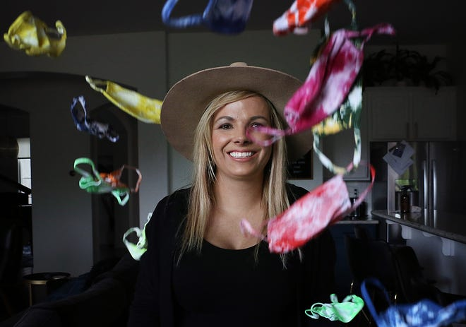 Cami Rowe poses for a portrait in her home in Reno on May 21, 2021. Rowe plans on collecting cloth masks and sewing them together to make quilts for the homeless.
