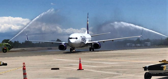 Avelo Airlines' first flight to Redding is greeted with water cannons shot from city of Redding air rescue vehicles at the Redding Municipal Airport on Thursday, May 20, 2021.