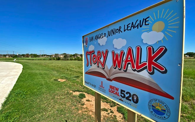 Signs designate the route for a story walk on a pedestrian path across from Unidad Park in San Angelo seen here in this Friday, May 21, 2021 photo.