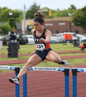 Faith Roberson, a former Wall High School standout in track and field who competes for the University of Texas-San Antonio, clears a hurdle during the 400-meter hurdles at the Conference USA Championships May 16, 2021, in Murfreesboro, Tennessee. She broke the UTSA record and the meet record in the event with a career-best time of 56.89 seconds.