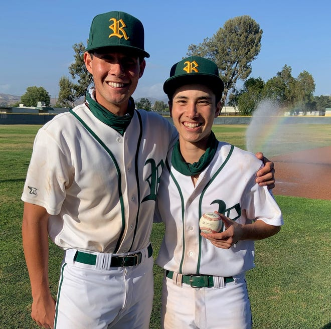 Riley Feigenbaum, right, poses with catcher Troy May after throwing a no-hitter to lead Royal to an 12-0 victory over Oak Park on Thursday.