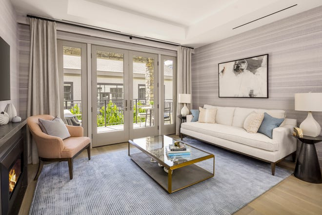 The living  room at a model unit in the St. Regis Residences in Rye was designed byElissa Grayer Interiors.