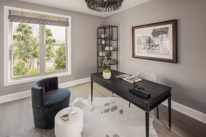 Dale Blumberg Interior Design created this den for a model unit at the St. Regis Residences in Rye.