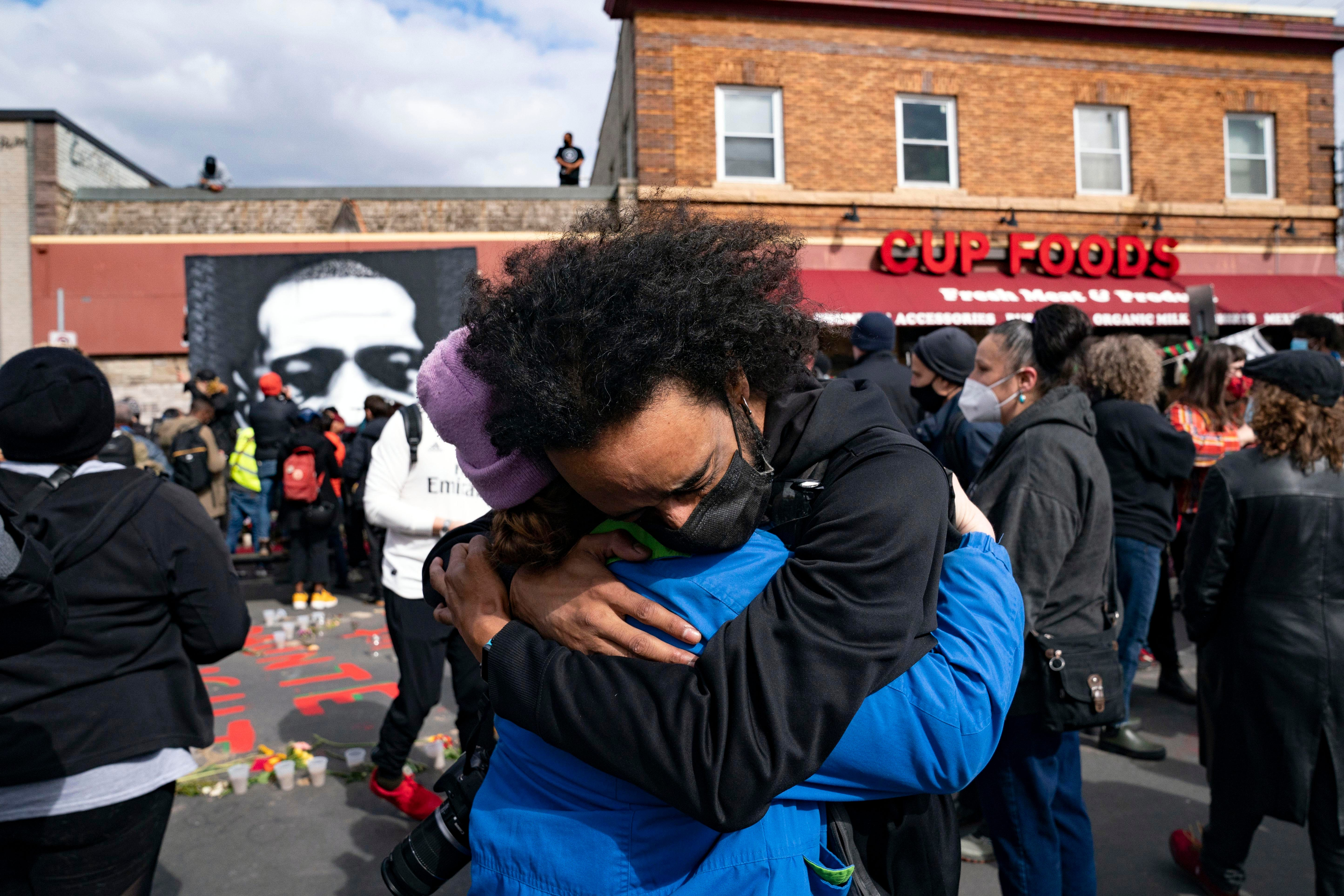 Nic Hernandez and Emma Ruddock hug in celebration after hearing the verdict of Derek Chauvin at George Floyd Square on April 20, 2021 in Minneapolis.