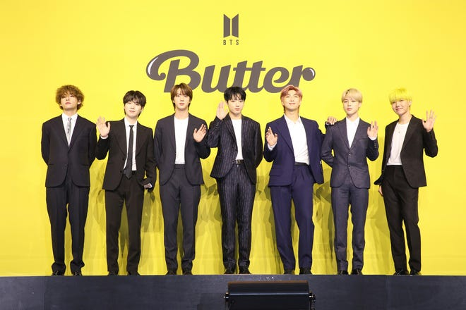 """BTS greets media at a press conference for the release of """"Butter."""""""