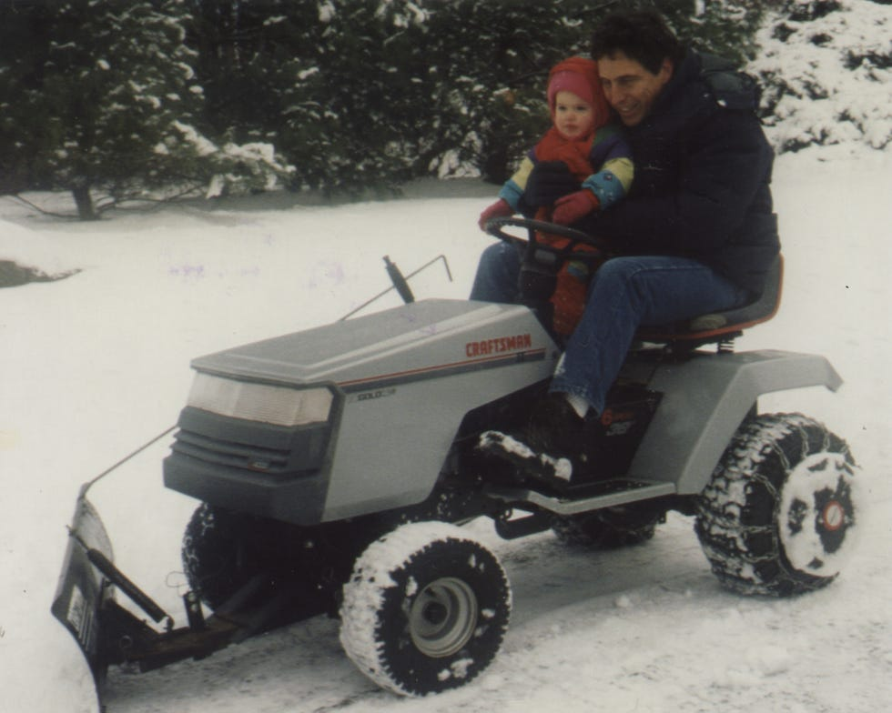Donald Greene plows his family's driveway with his daughter Jody.