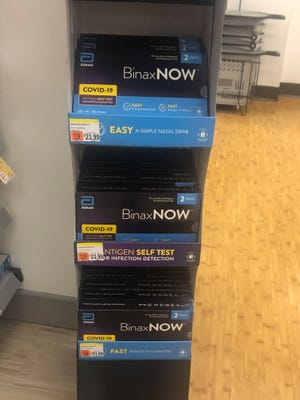 At-home COVID tests for sale at a drugstore. The CDC now allows at-home tests to be used to meet its requirement of a negative test before boarding international flights to the United States.