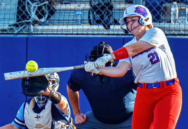 Lauren Tetreault hits a pitch out of the park during Leander's 14-1 win over Corpus Christi Carroll on Friday in a Class 5A regional semifinal. The Lions belted four home runs in the victory.