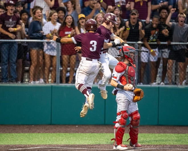 Round Rock second baseman Jake Castillo, left, celebrates with Mason Schronk after Castillo scored Friday during the Dragons' 9-1 win, which clinched a sweep of Lake Travis in a Class 6A regional quarterfinal series.