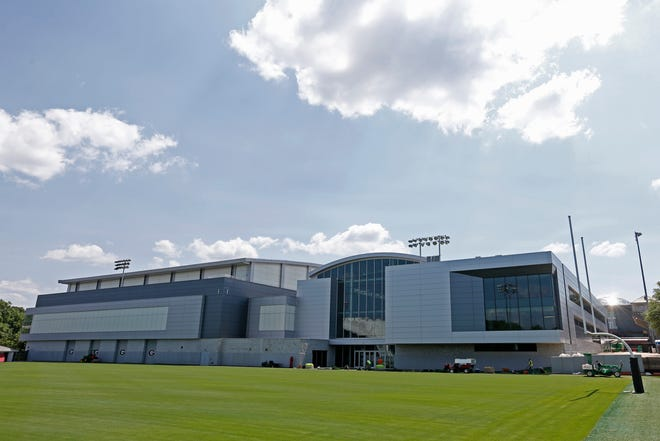 UGA football's new football operations center next to the school's indoor practice facility in Athens, Ga., on Friday, May 21, 2021.