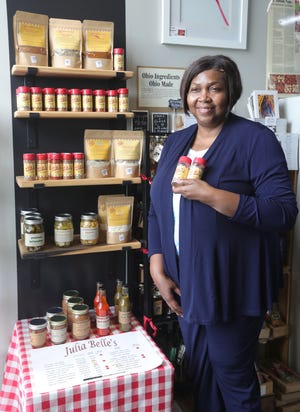 Tanya Green, owner of Akron-based Julia Belle's Seasonings, with her display at Northside Marketplace on Furnace Street. The bulk of Green's business, which she says was inspired by her mother's skill at cooking, includes a selection of spice blends and mixes that is sold online across the country.