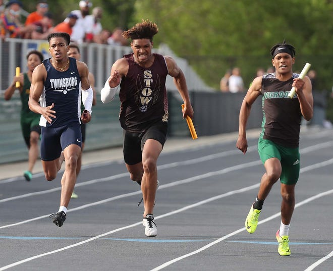 Jonathan Banks, right, of Nordonia edges out Alexander Branch, left, of Twinsburg and Xavier Preston of Stow to anchor his team to a victory in the 4x200 meter relay during the Div. I District Track Meet at Nordonia High School Friday, May 21, 2021 in Macedonia, Ohio.