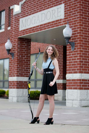 Mogadore High School senior Sophia King, a Star Student, holds her archery bow. She will study engineering at Carnegie Mellon University.
