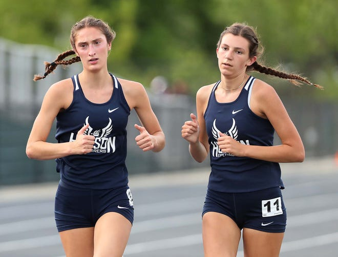 Emmaline Hannan, right, of Hudson and teammate Brenna Beucler, run to a first and second place finish in the 1600 meter run during the Div. I District Track Meet at Nordonia High School Friday, May 21, 2021 in Macedonia, Ohio.