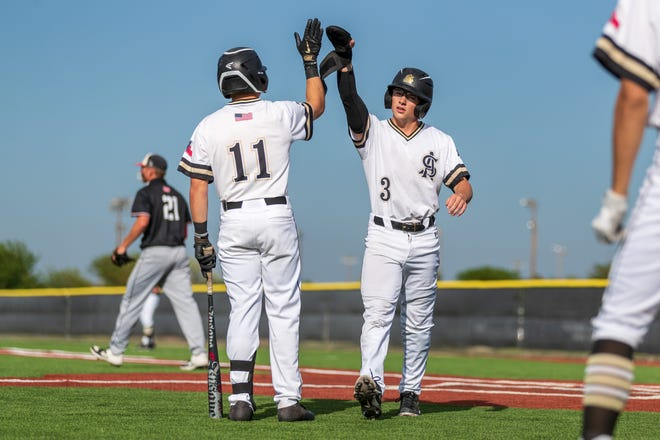 Amarillo High's Bryson Slaughter (11) high fives his teammate Jake Maynard (3) during a Class 5A regional quarterfinals game on May 21, 2021 in Amarillo at Sandie Field.