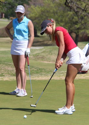 Plainview's Reagan Chaney, right, makes a putt as Dickson's Parker Garrett looks on earlier this season. The pair join Plainview's Lindyn Ross and Turner's Luke O'Dell on the all-state golf teams.