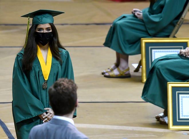 Rock Bridge High School senior Tala Al Jauni receives her diploma Friday at Mizzou Arena.