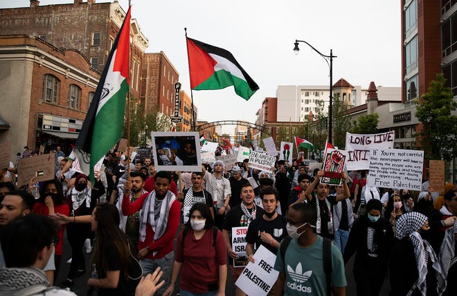 Hundreds of people travel north on High Street from Goodale Park to support the liberation of Palestine in Columbus, Ohio on May 21, 2021.