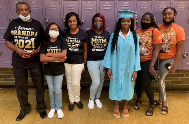 Tra'Neyzah Kiara Sargent poses with her family before the Virtual Academy of Lafourche graduation ceremony on Friday night at the Thibodaux High School auditorium.
