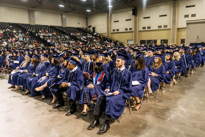 Fletcher Technical Community College graduates listen to the keynote speech by Synergy Bank President and CEO Jerry Ledet Jr. during Friday's commencement at the Houma-Terrebonne Civic Center.