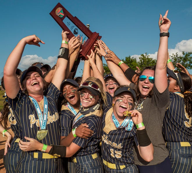 The Eustis Panthers celebrate with the championship trophy Friday after winning FHSAA Class 4A state championship with a 5-0 win against Brooksville Hernando High School at Legends Ball Fields in Clermont. [PAUL RYAN / CORRESPONDENT]