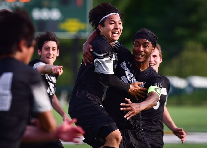 Herkimer's Yohan Kim, center, celebrates with teammates after scoring a goal during the men's NJCAA Region III finals against Mohawk Valley Community College on Friday, May 21, 2021 at Wehrum Stadium. Herkimer won 2-1.