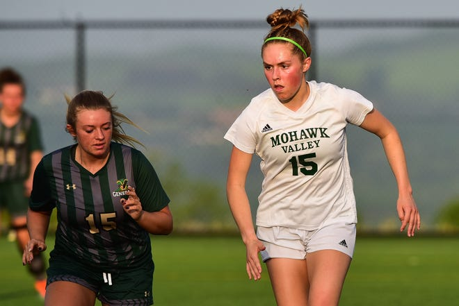 Mohawk Valley Community College Hawk Reilly Rich (right) moves the ball against Herkimer College defender Hannah Spofford during the women's NJCAA Region III final May 21 at Wehrum Stadium.