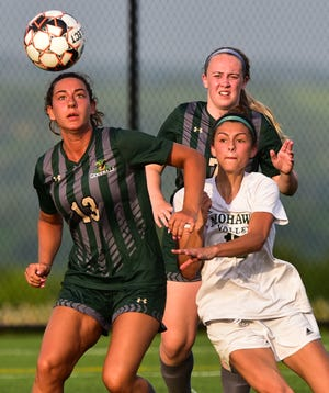 Mohawk Valley Community College player Emily Berube, right, fights for the ball with Herkimer's Taya Yacobucci (13) and Jazmyn Gillette during the women's NJCAA Region III finals on Friday at Wehrum Stadium. MVCC won 4-1.