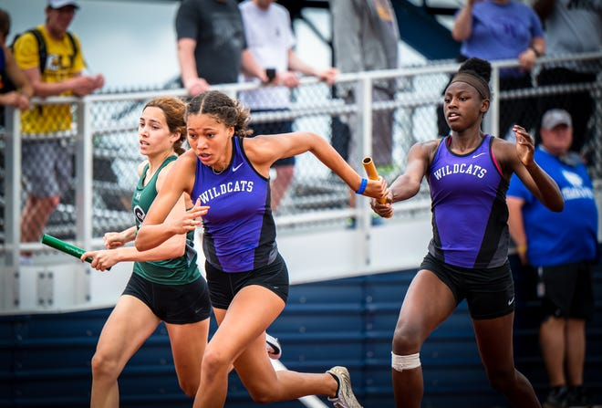 Blue Springs freshman Ariana Jackson, left, takes the baton from teammate Arianna Calloway during the 800-meter relay in the Class 5 Sectional 4 meet Friday at Liberty North High School. The Wildcats won in a time of 1 minute, 41.46 seconds and earned three relay wins to advance to next week's state championships.