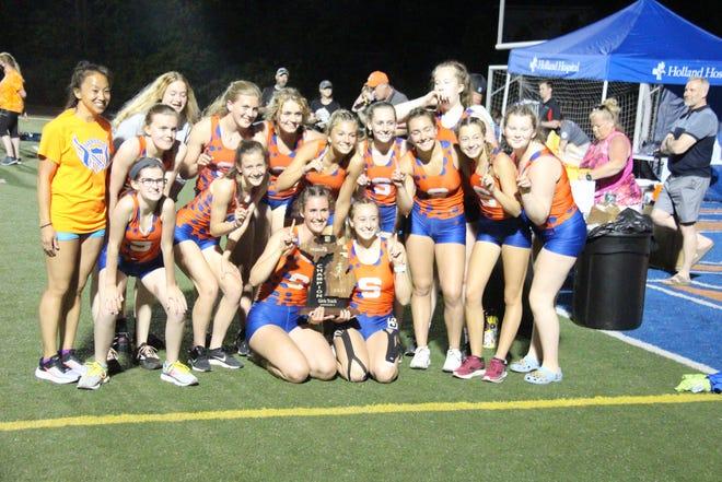 The Saugatuck girls track team celebrates their regional win on Friday