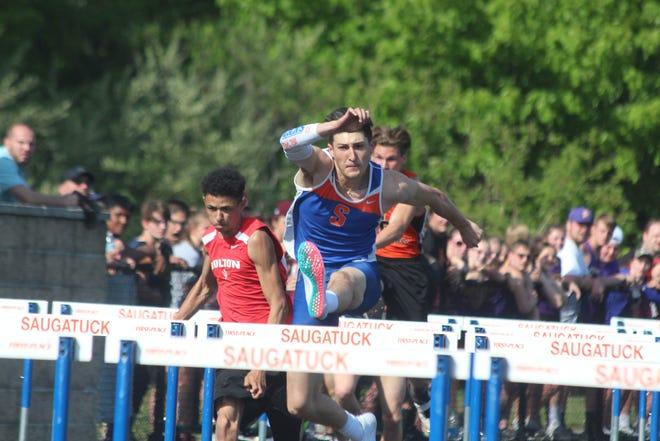 Saugatuck's Benny Diaz leaps over a hurdle