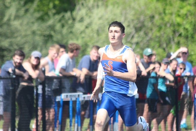 Both the Saugatuck boys and girls track teams won the regional title on Friday