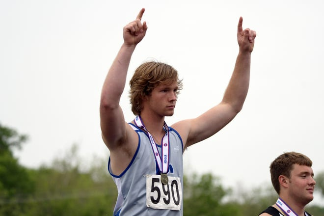 Putnam County's Colder Evans reacts as he is announced as the Class 2 discus champion on Friday at the MSHSAA State Track Tournament.