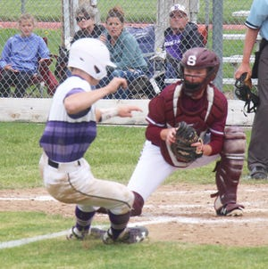Swink High School catcher Justin Paolucci looks to put the tag on Rye's Joe Valdez in the second game of a doubleheader on Saturday. The Lions lost both games by scores of 13-2 and 8-3.