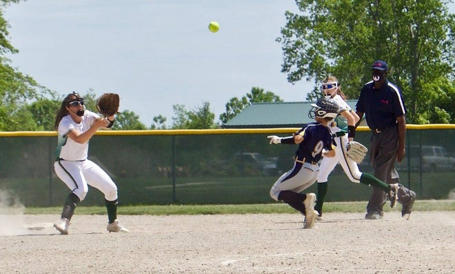 Shay Alexander of Whiteford tries to steal second base as St. Mary Catholic Central shortstop Emily Theisen takes the throw. The teams split with Whiteford winning the first game 4-0 and SMCC taking the second 6-5.