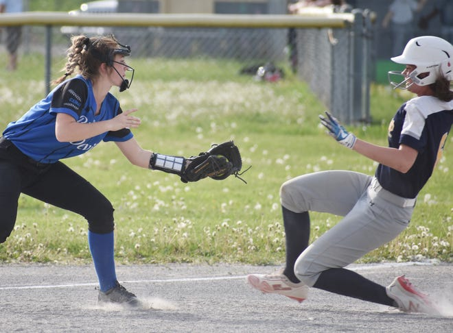 A Camden player tags out a Notre Dame base runner during a game Friday, May 21, 2021 at Wankel Softball Field in Utica. Camden won 23-2.