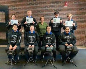 Nancy Varallo, CEO of Project Steno, and Criminal Justice Vocational High School students celebrate the last day of their steno program.